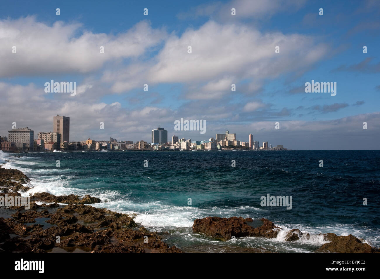 Landscape photograph of the Vedado area with tall buildings and skyscrapers by the sea shoot on a bright day with - Stock Image