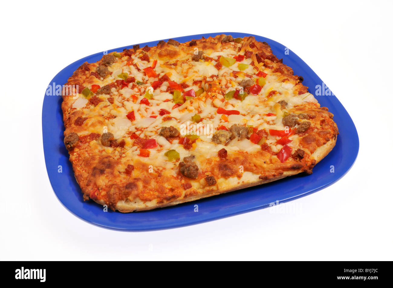 Cooked rectangle pizza on blue plate on white background, cutout. - Stock Image