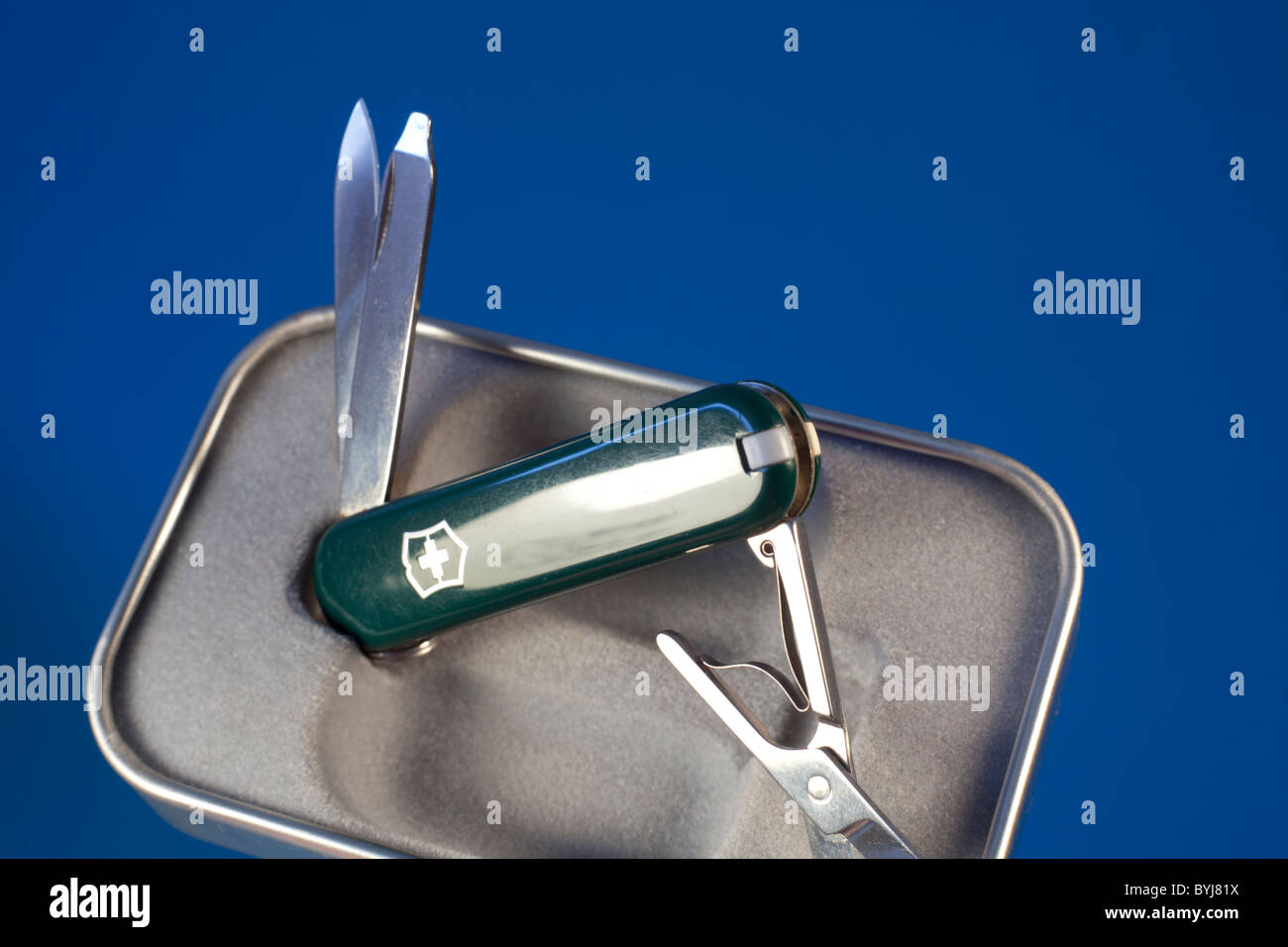 A executive swiss army knife in green - Stock Image