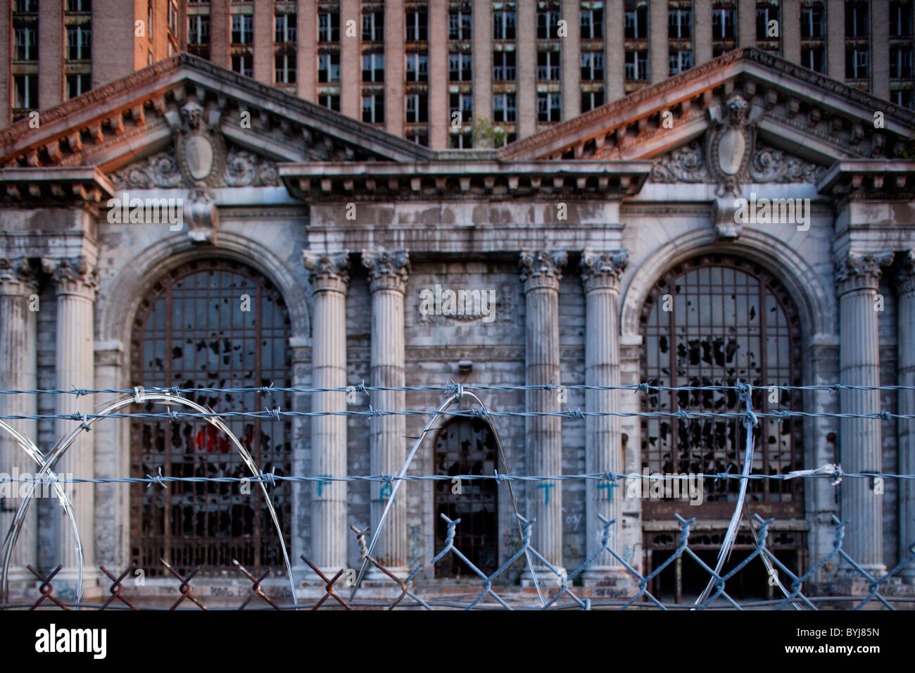 USA, Michigan, Detroit, Barbed wire fence surrounds abandoned Stock ...