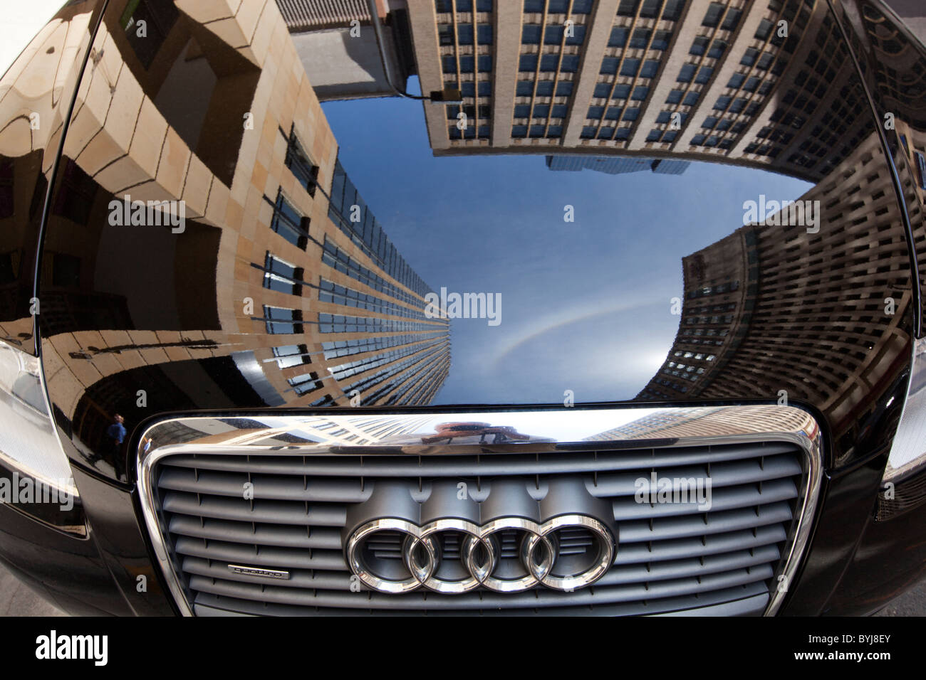USA, Minnesota, Minneapolis, Reflection of office building in Audi car's hood Stock Photo