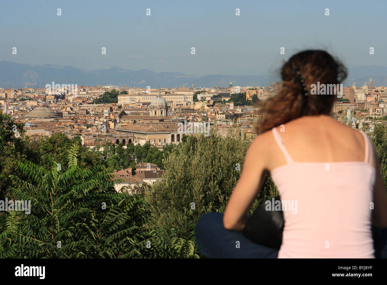 A woman enjoying the view from the Gianicolo Hill, Rome, Italy Stock Photo