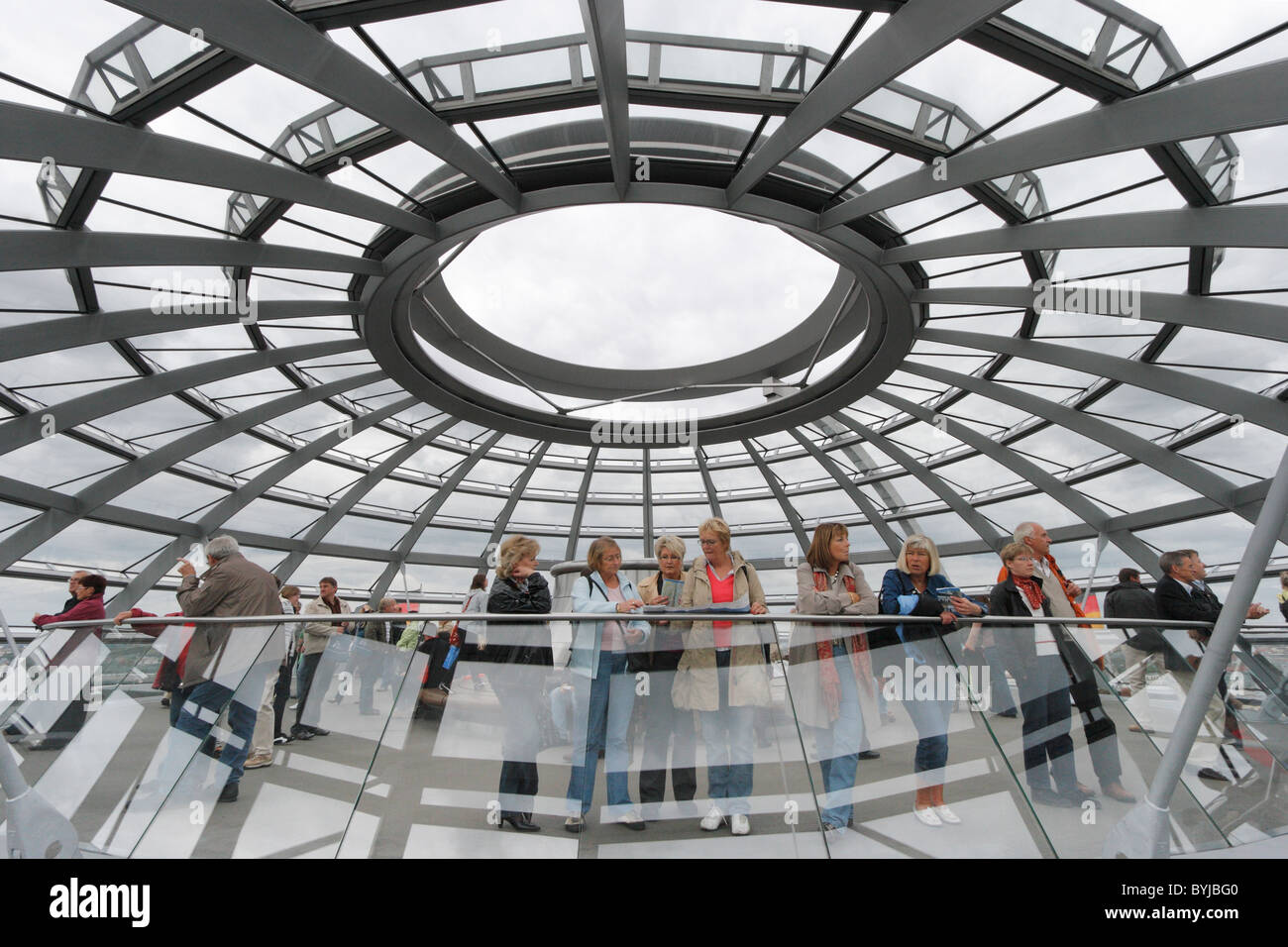 Visitors in the dome of the Reichstag, Berlin, Germany - Stock Image