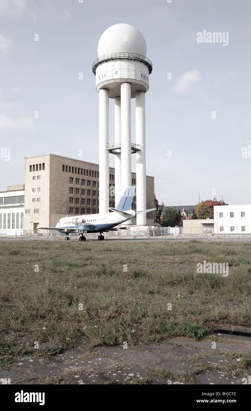 Historic airplane and buildings at new city public Tempelhofer Park on site of famous former Tempelhof Airport in - Stock Image