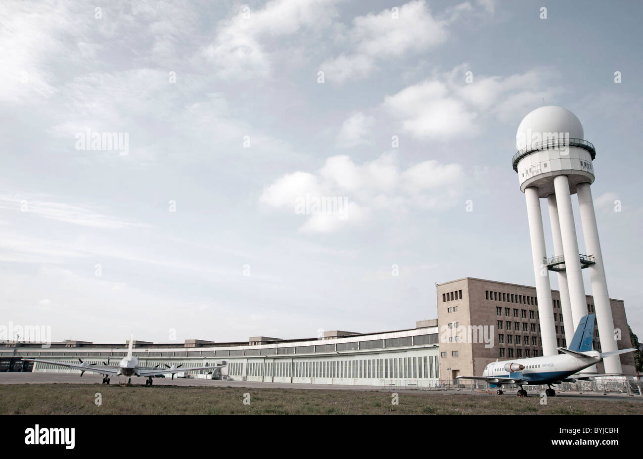 Historic airplanes and buildings at new city public Tempelhofer Park on site of famous former Tempelhof Airport - Stock Image
