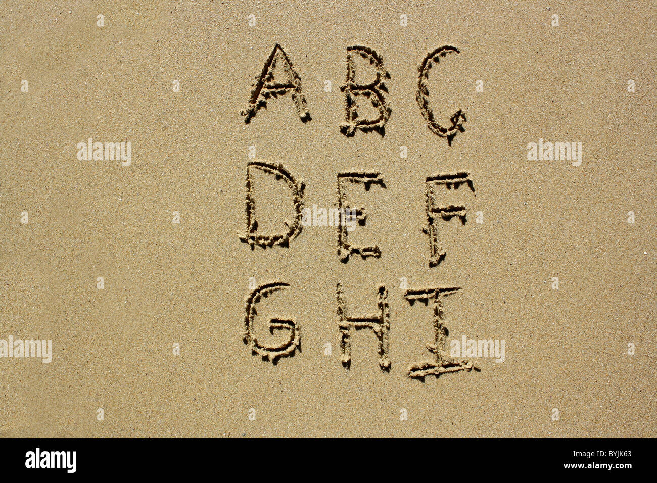 The letters A-I written out in wet sand. Please see my collection for more similar photos. Stock Photo