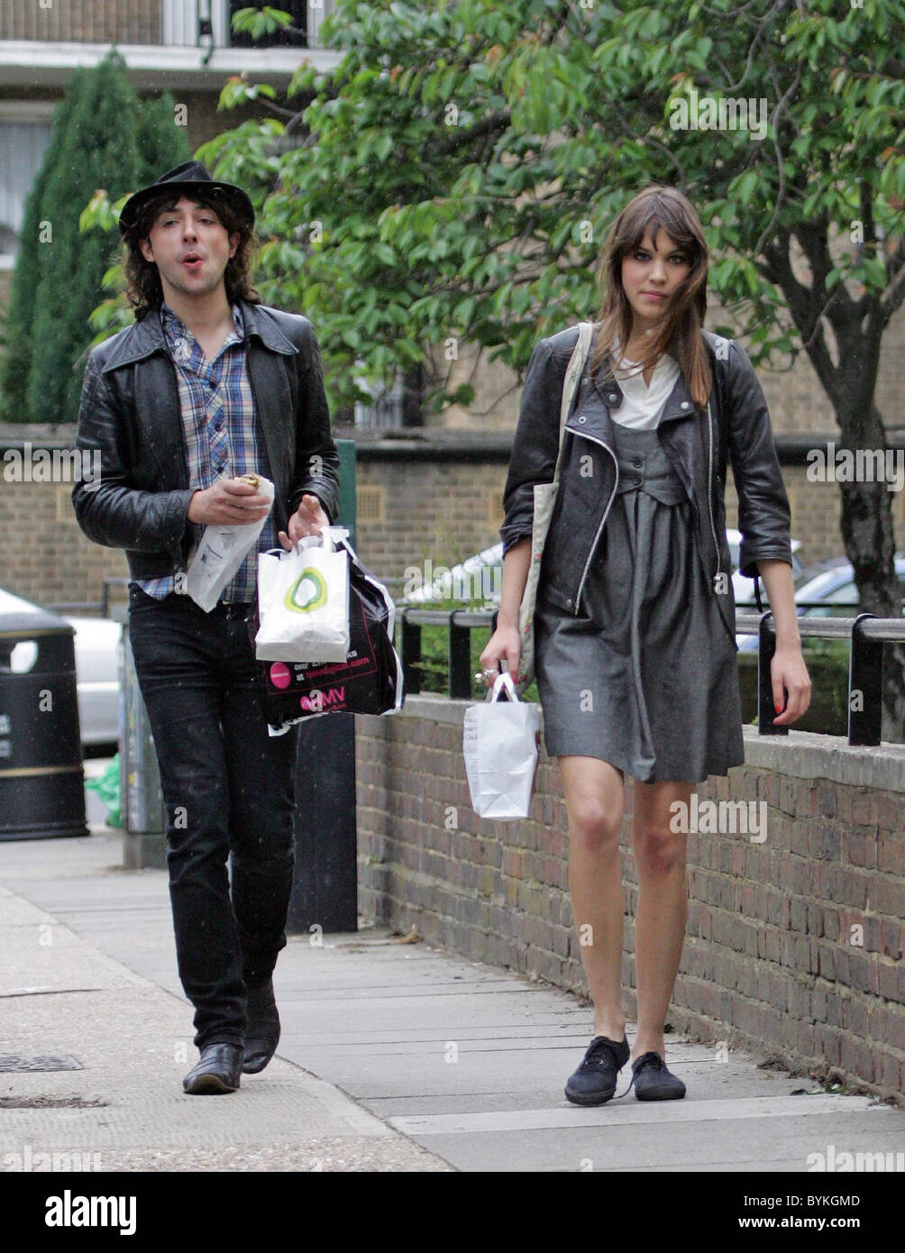 alex zane and alexa chung return to their studio after going out