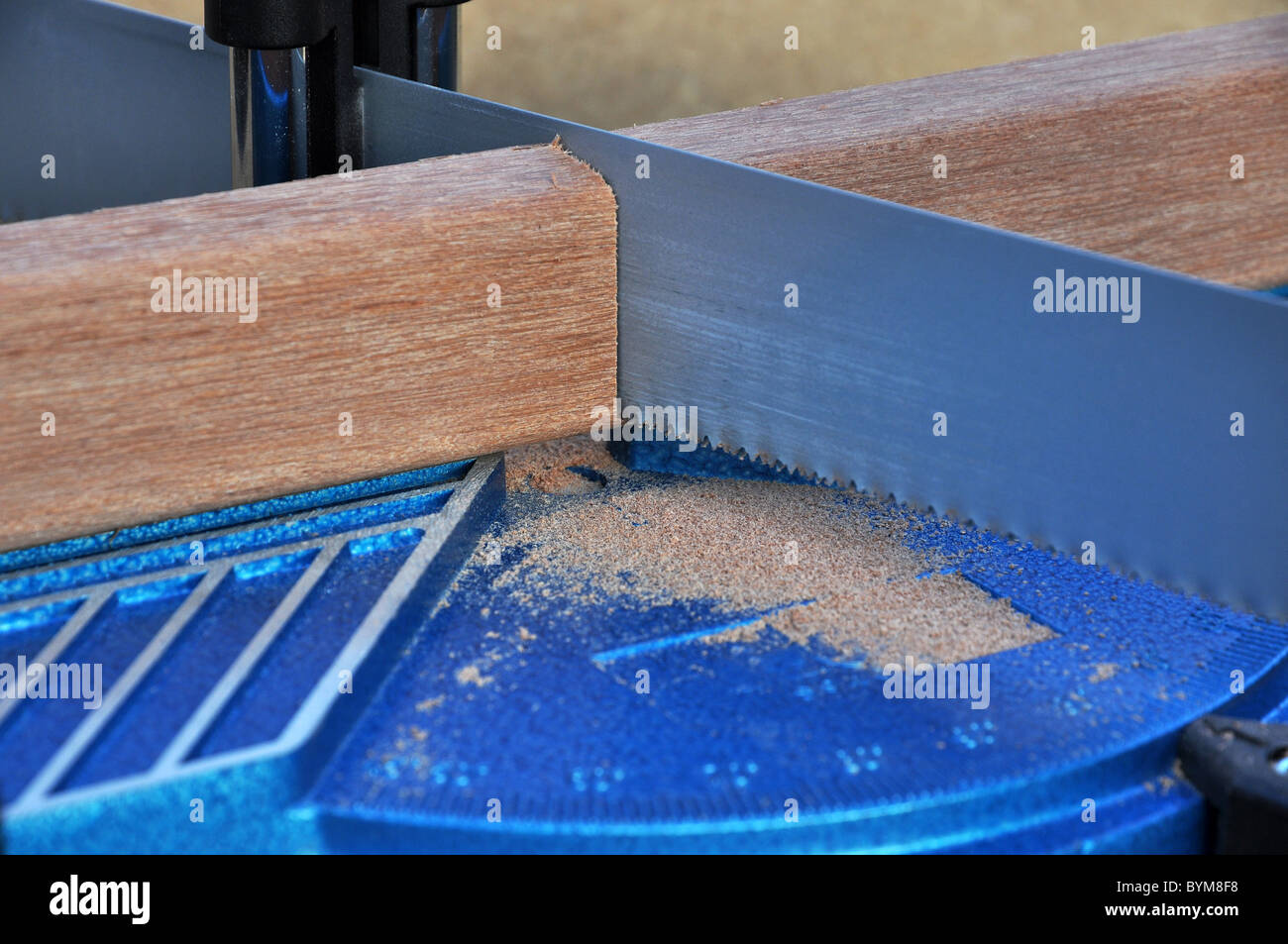 Close up of cutting a board with miter saw Stock Photo
