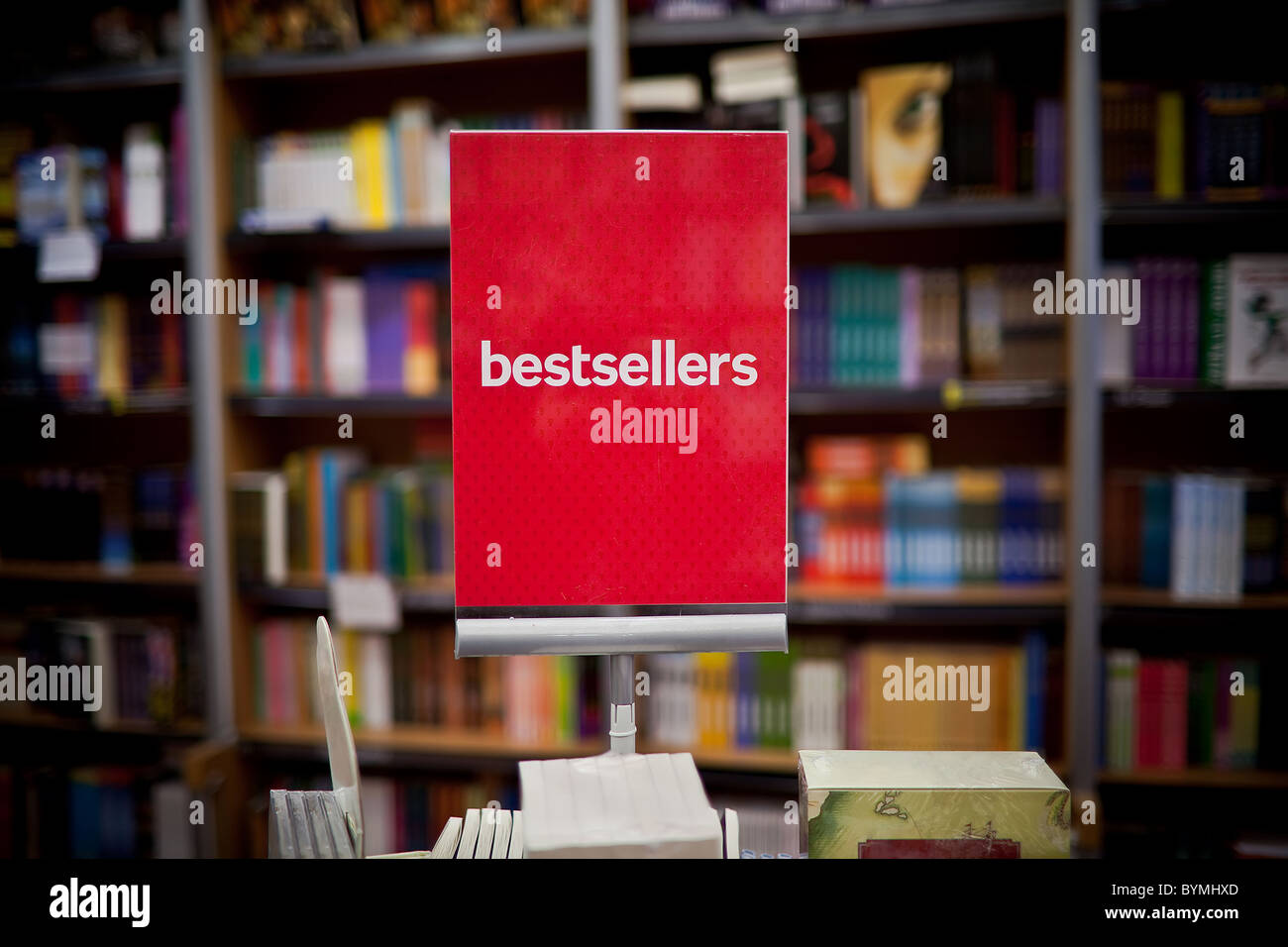 Bestsellers area in bookstore - many books in the background. - Stock Image