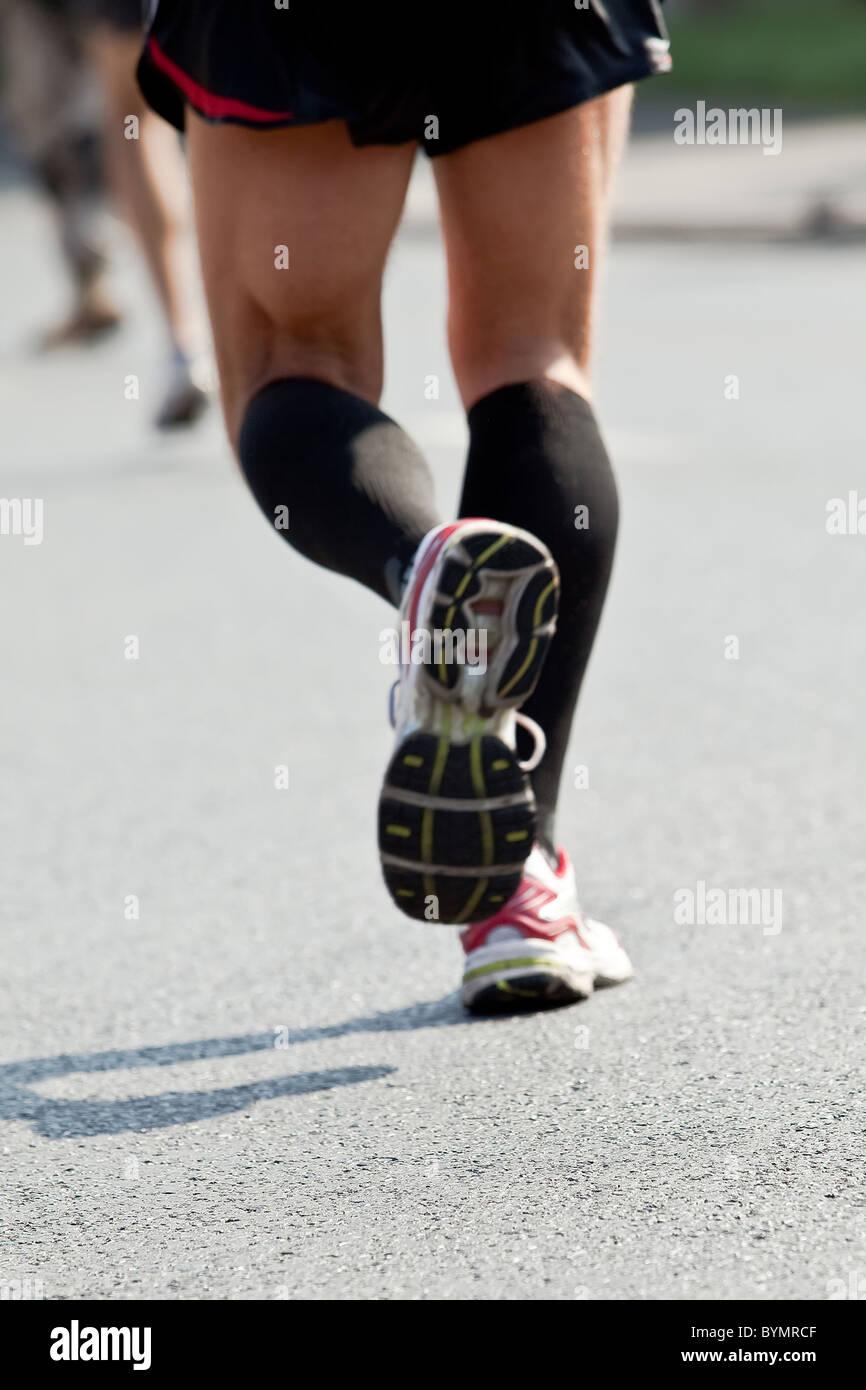 Man running in city marathon - motion blur - Stock Image