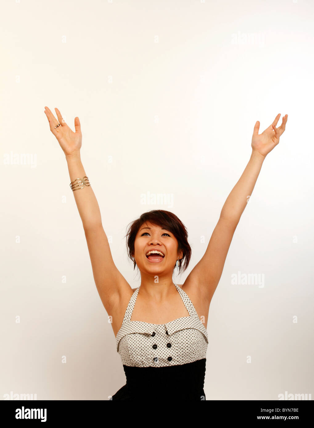 Oriental girl cheering - generic - Stock Image