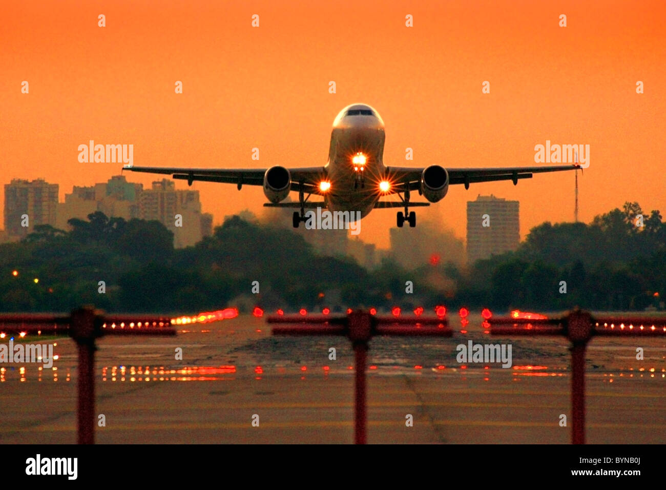 jet commercial airplane taking off the Jorge Newbery Airport, at sunset. - Stock Image