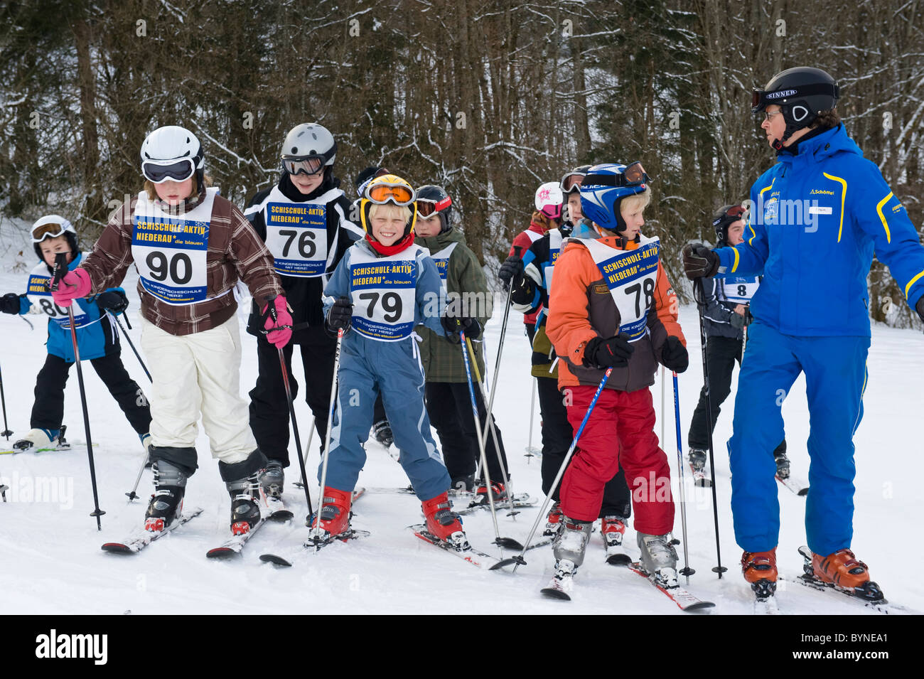 Children with instructor attending a ski course in Niederau in Austria - Stock Image