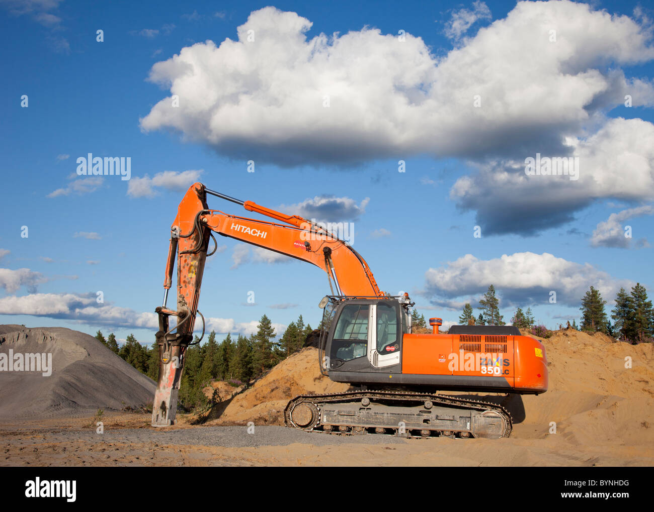 Hitachi ZAxis 350 lc excavator equipped with hydraulic rock breaker for rock quarry usage - Stock Image