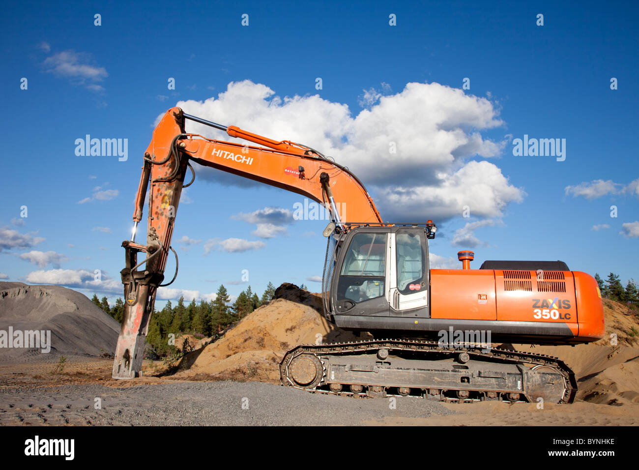 Hitachi ZAxis 350 lc excavator equipped with hydraulic rock breaker for rock quarry usage , Finland - Stock Image