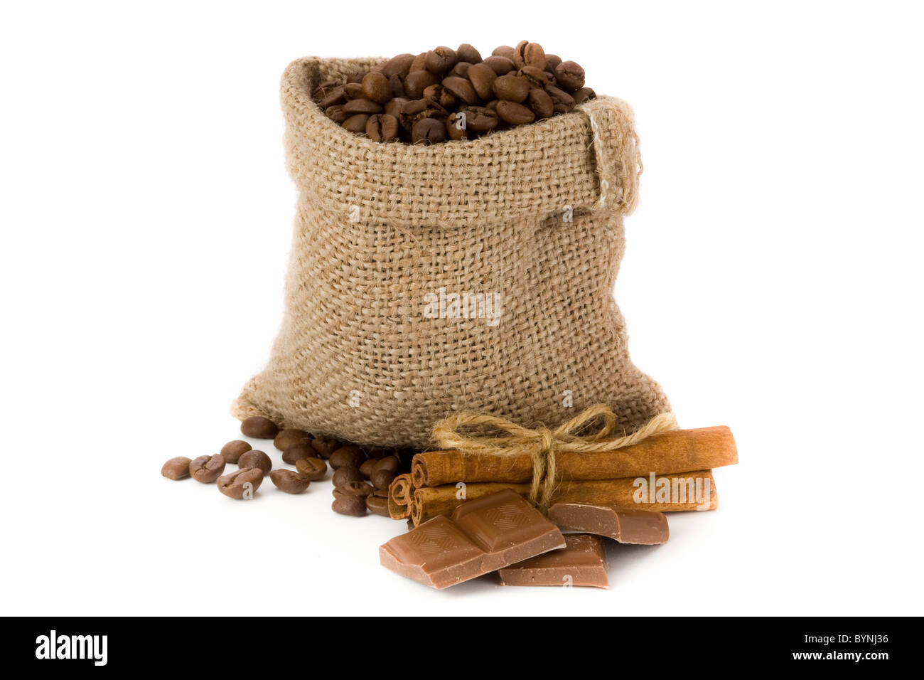 Coffee beans in canvas sack with cinnamon and chocolate - Stock Image