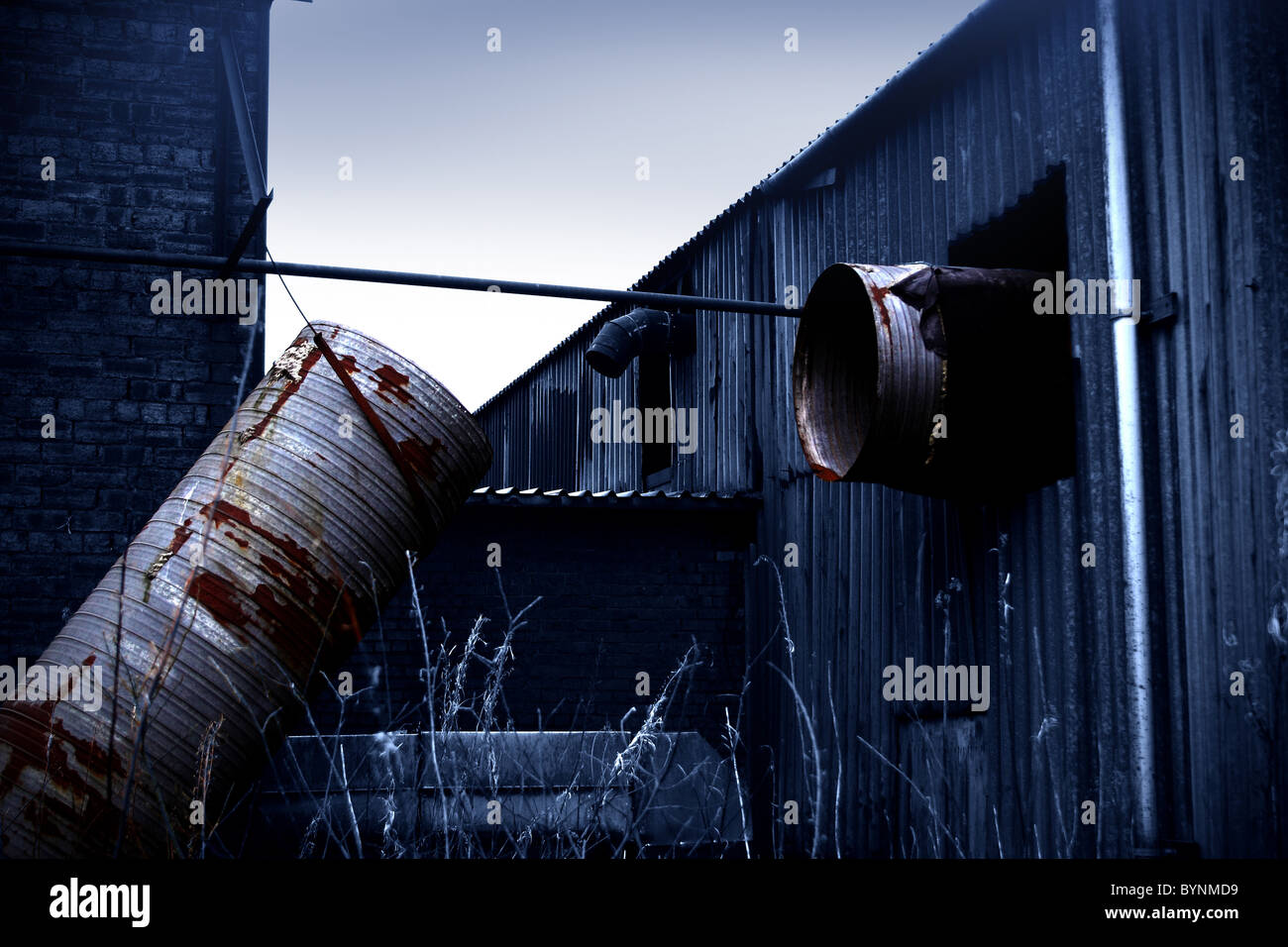 Derelict factory with metal sheeting - Stock Image