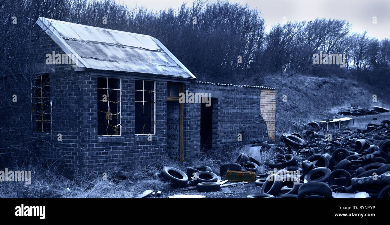 Derelict tyre yard with abandon shed - Stock Image