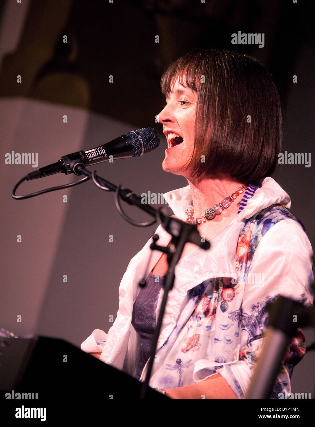 Female singer/vocalist Joanne Hogg fronting the Celtic Rock band Iona on stage in Newmarket, May 2010 - Stock Image