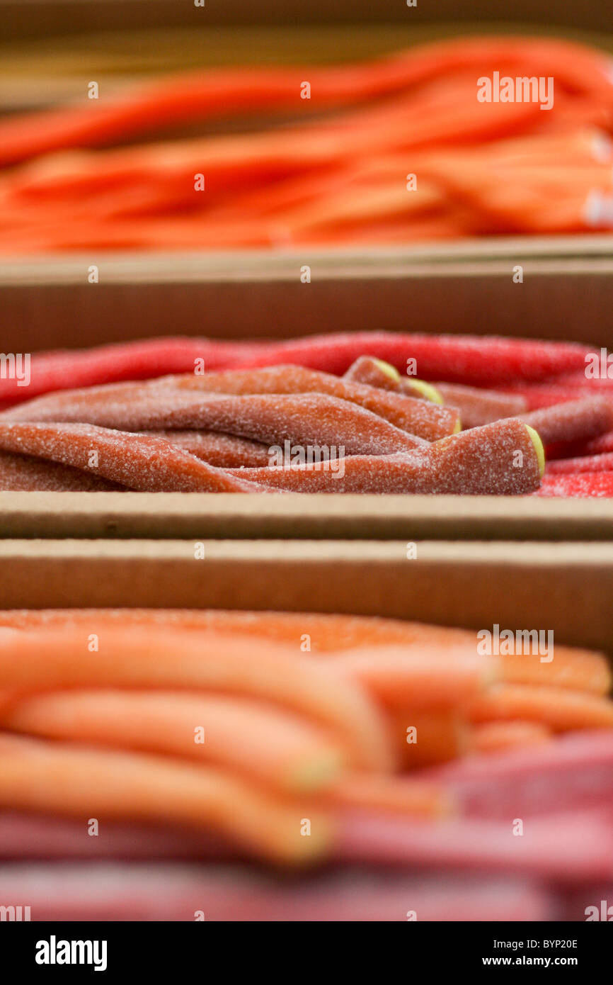 Sweet fondant-filled liquorice strings for sale at an Italian market - Stock Image