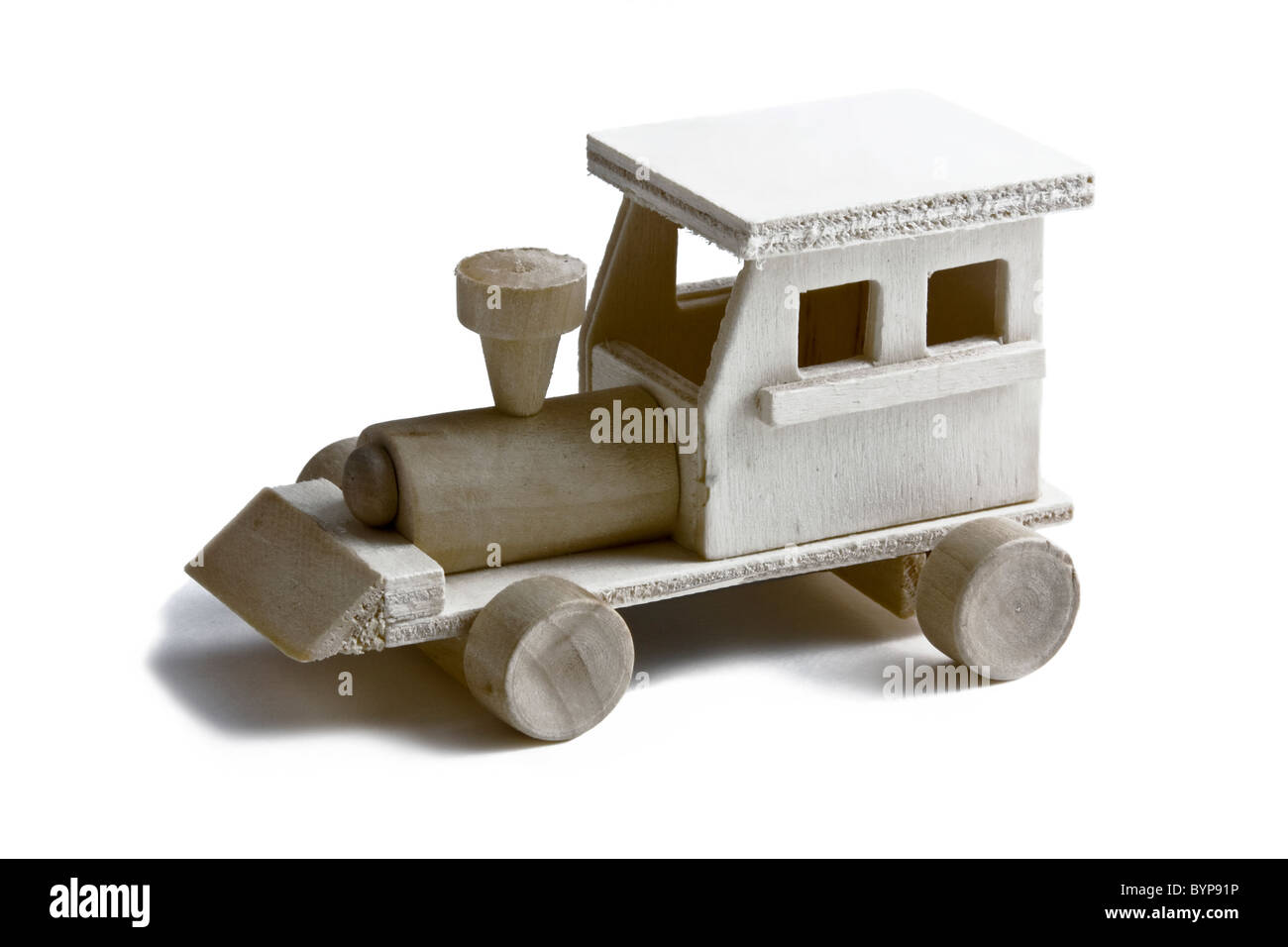 Wooden toy train with wheels on white background - Stock Image