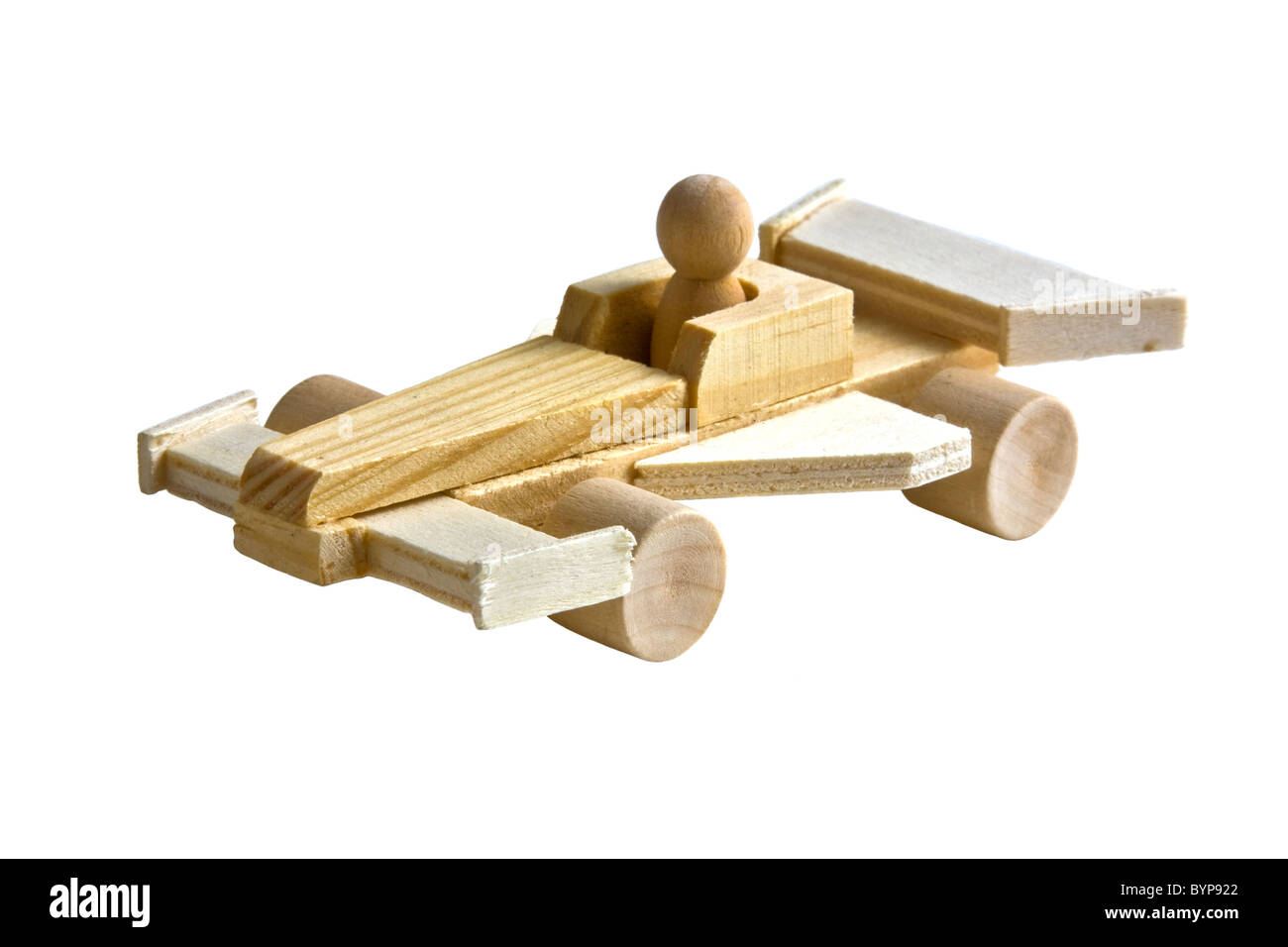 Wooden toy race car with driver on white background - Stock Image