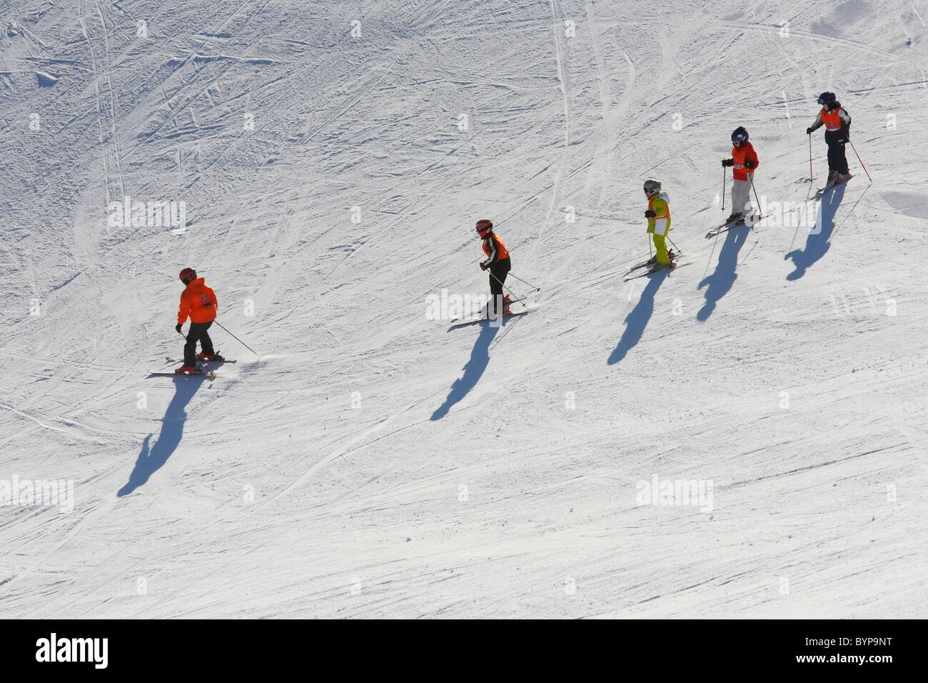 Instructor teaching children skiing in Zillertal,  Austria, Europe - Stock Image