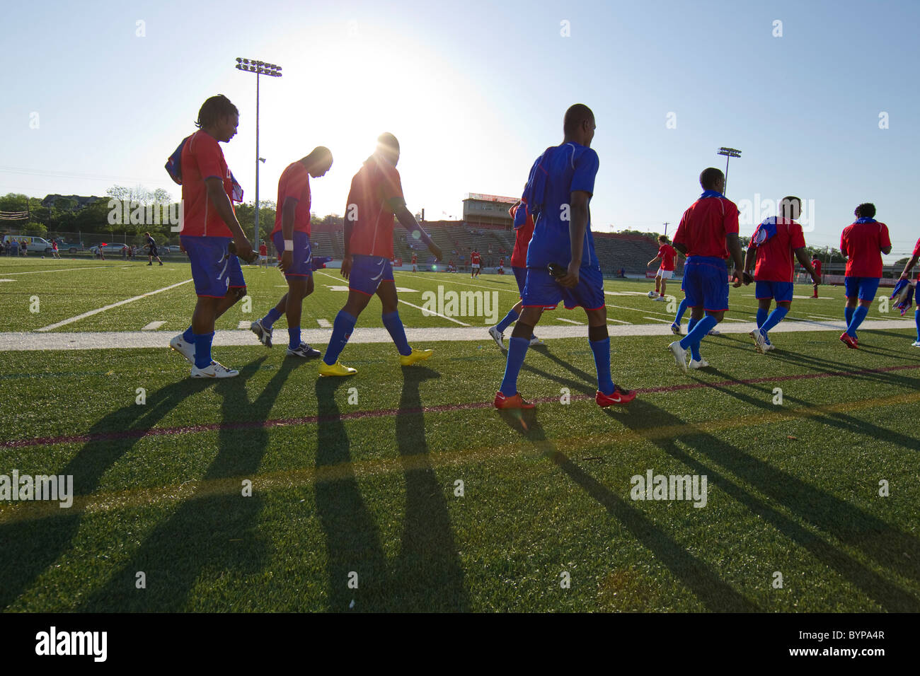 Haitian National Soccer team members walk to bench before exhibition match in Austin Texas. - Stock Image