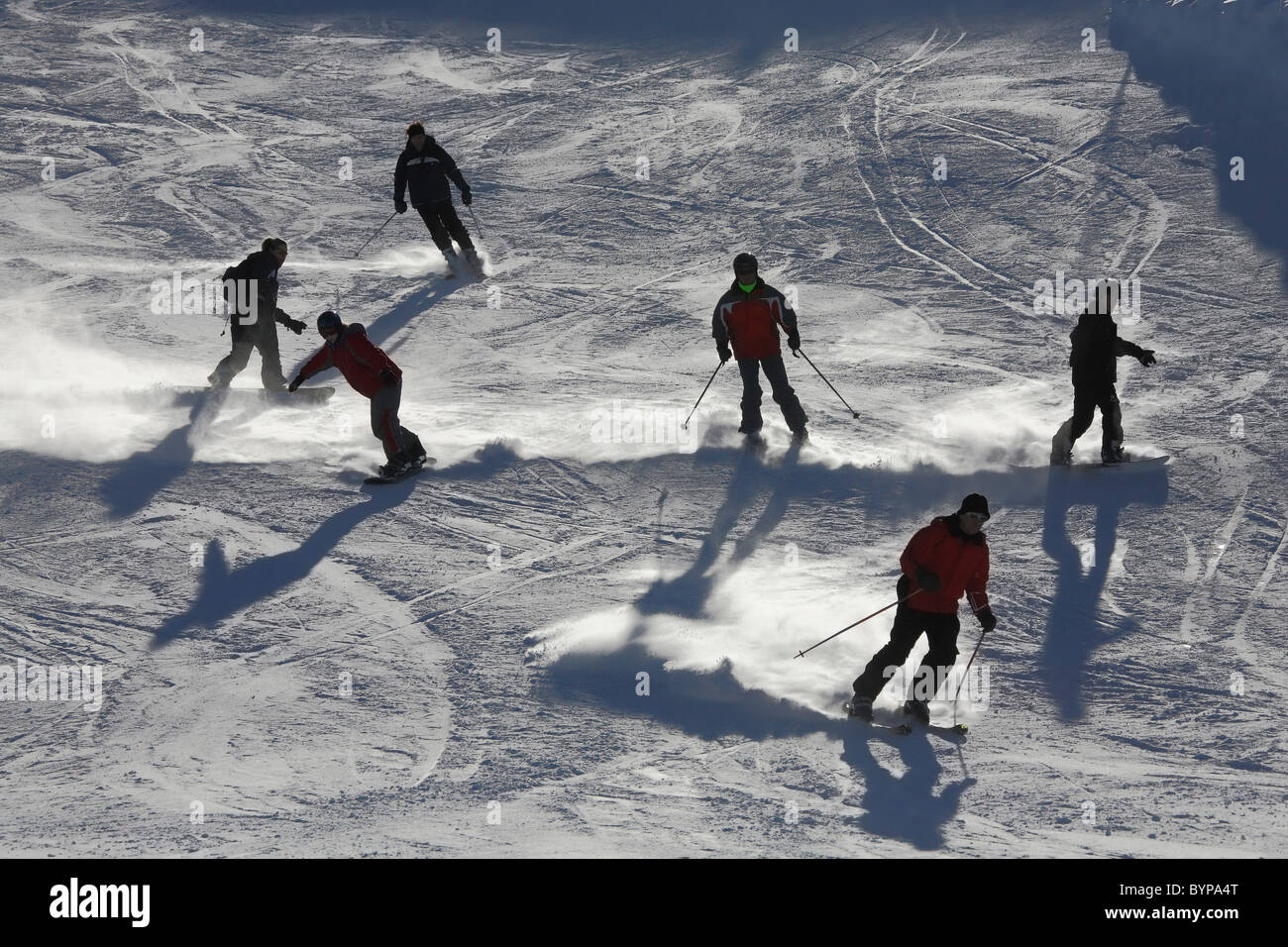 Skiers skiing on the hills of  Austria, Zillertal, Europe - Stock Image