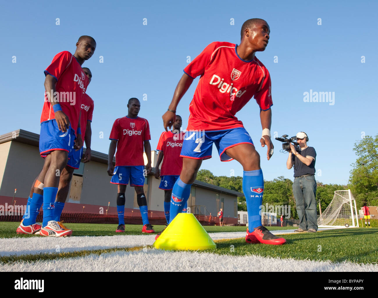 online retailer 022c7 597c5 The Haitian National Soccer team warms up on the field ...