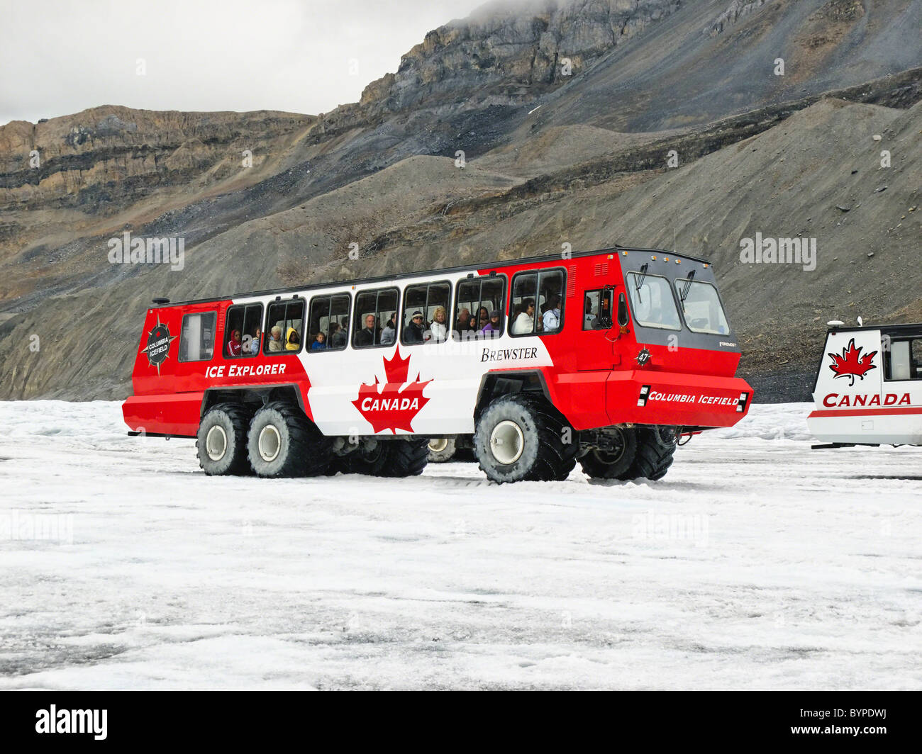 Snow Coach Carrying Tourist onto the Athabasca Glacier, Alberta, Canada - Stock Image