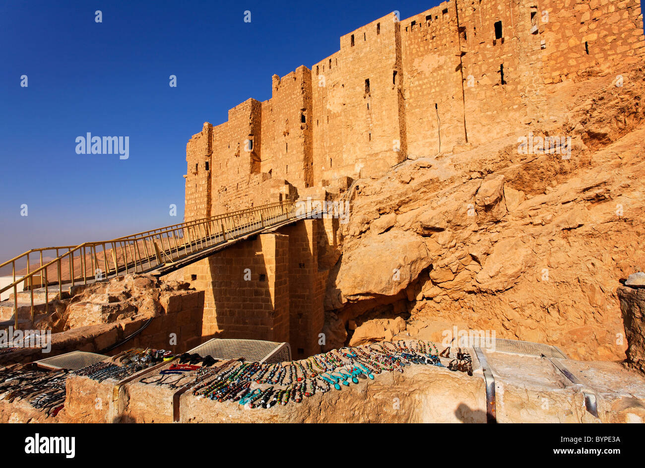 Souvenir jewellery for sale in front of Qalaat Ibn Maan, the Arab Castle, at Palmyra, Syria - Stock Image