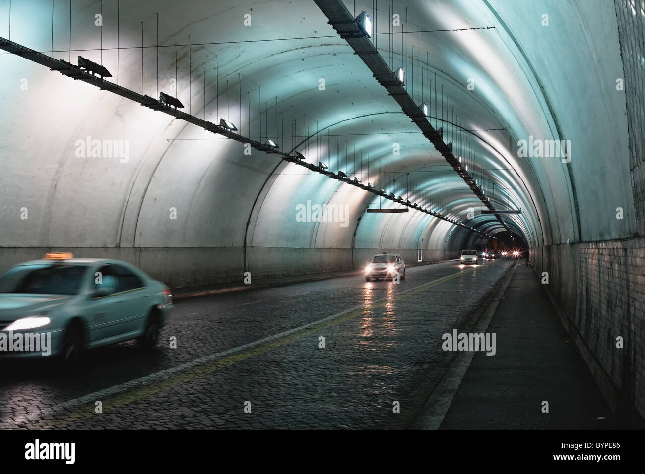 Cars Passing Through a Tunnel, Via Del Traforo, Rome, Italy - Stock Image