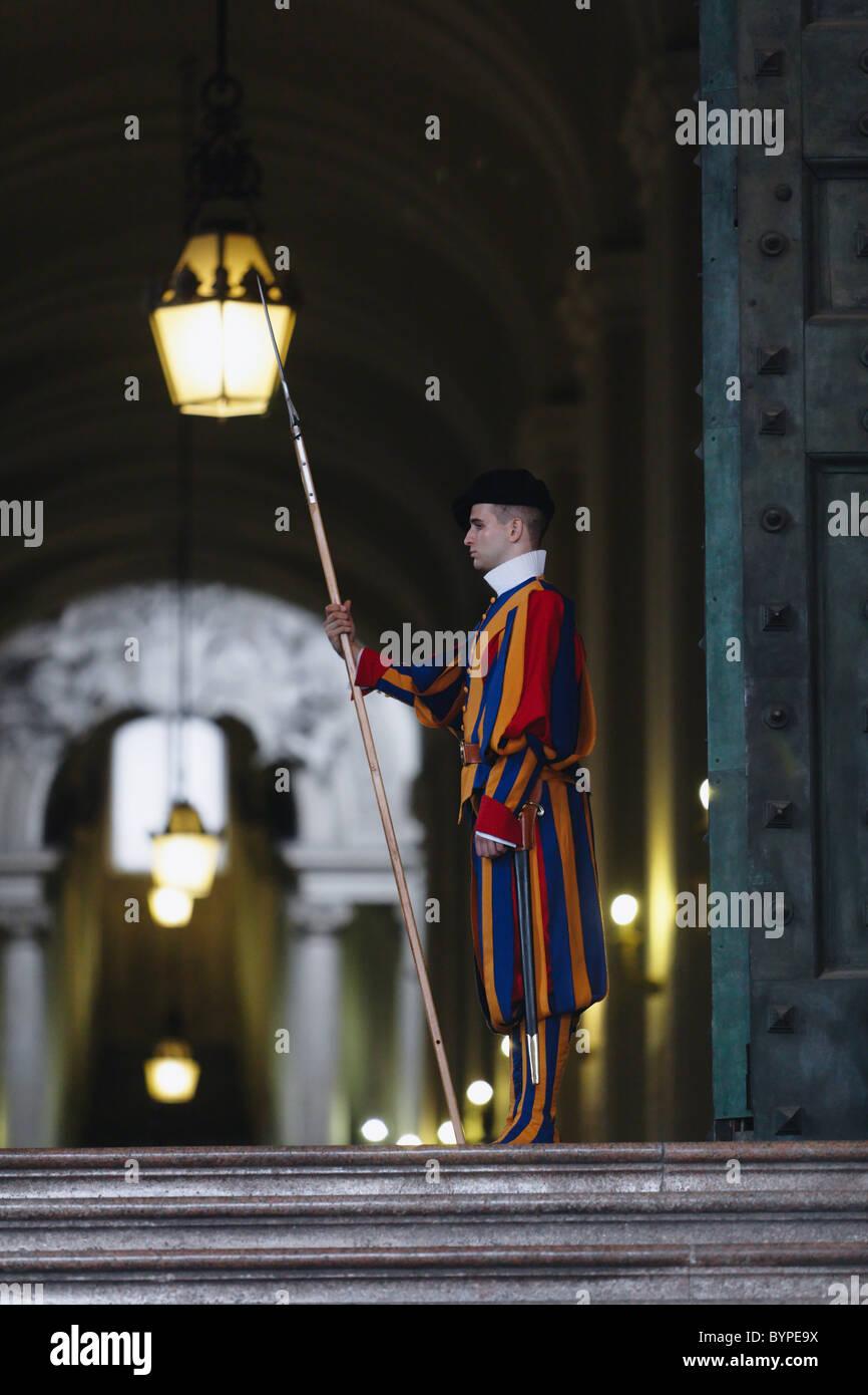 Papal Swiss Guard Guarding The Bronze Door of the St Peter's Basilica - Stock Image