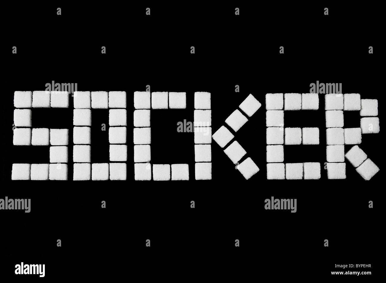 das Wort Socker aus Wuerfelzucker zusammengesetzt, Word, sugar cubes - Stock Image