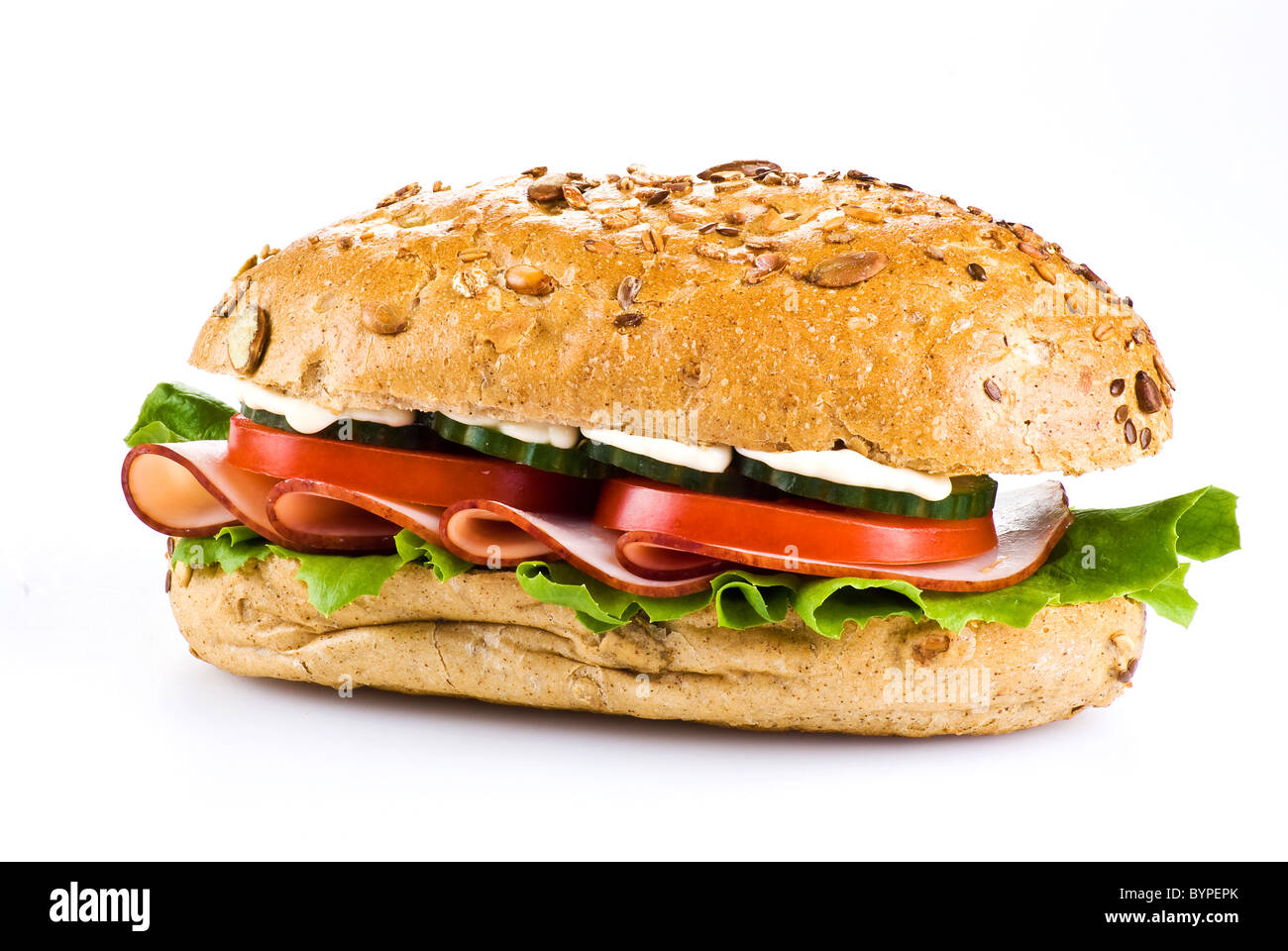 Freshly made sandwich with ham and vegetables over white - Stock Image