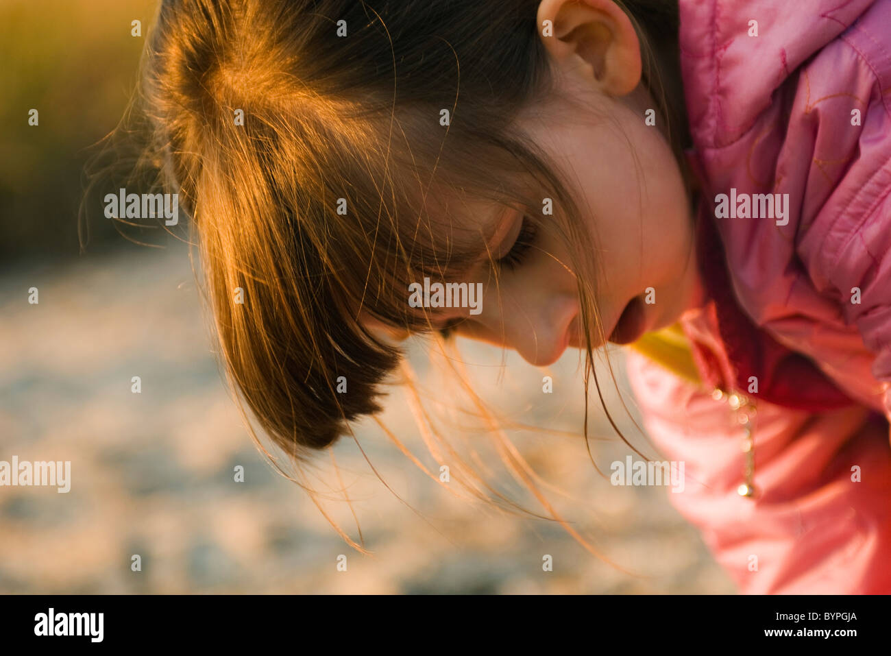 Young girl outdoors - Stock Image