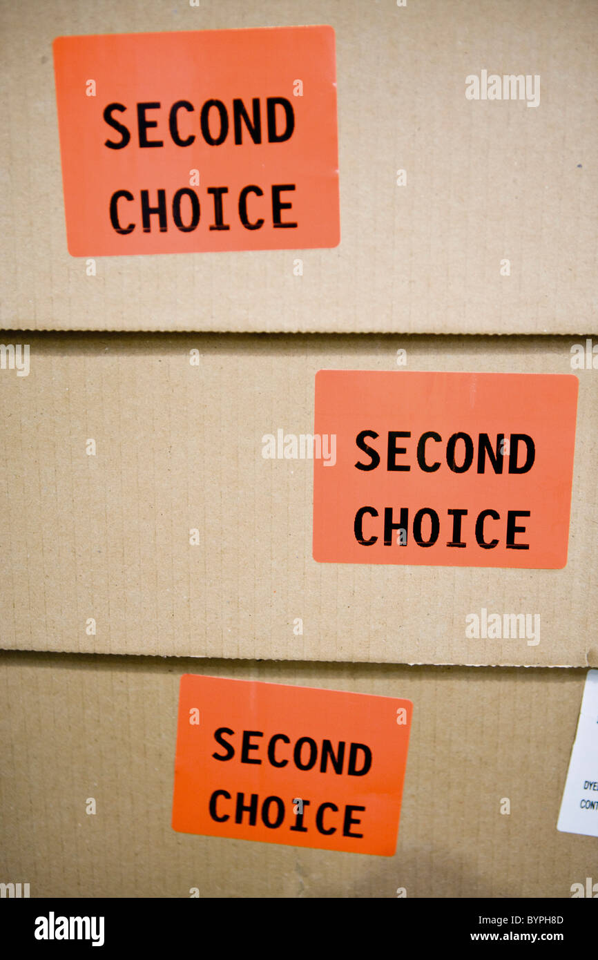 Cardboard boxes labeled with stickers reading 'second choice' - Stock Image