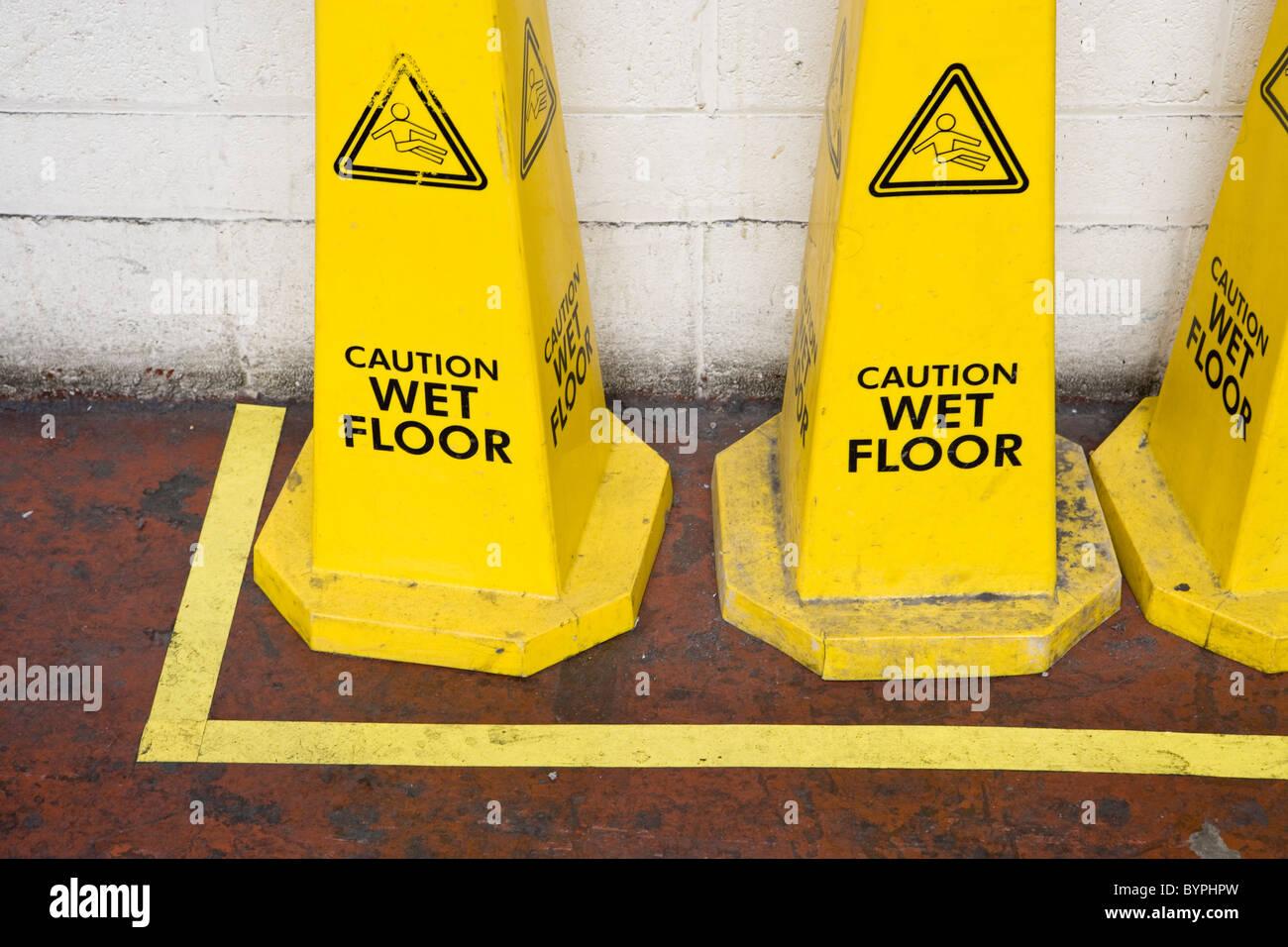 Caution wet floor signs - Stock Image