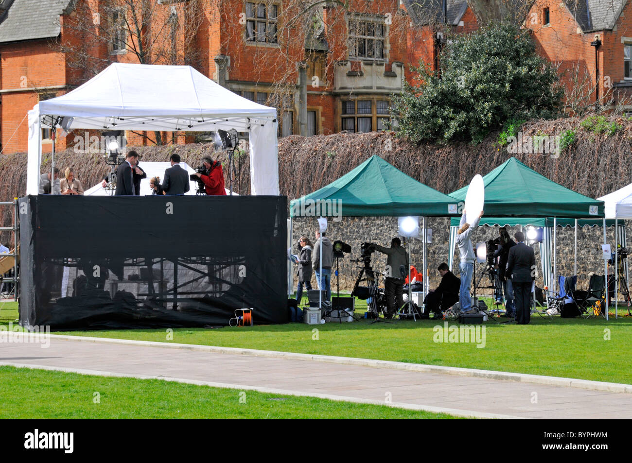 Broadcasting news crews and spectators on College Green at election time - Stock Image
