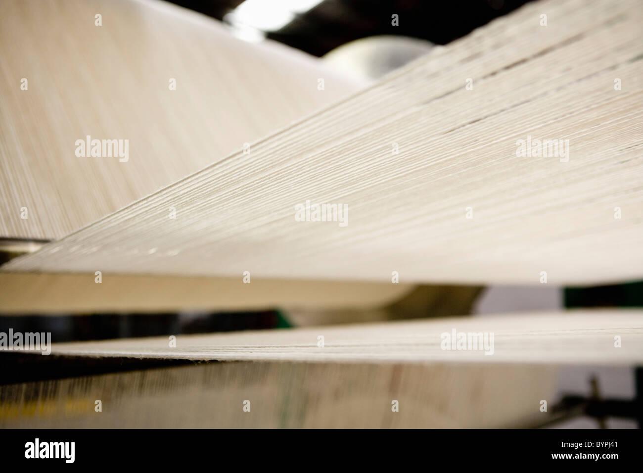 Carpet weaving loom in carpet tile factory - Stock Image