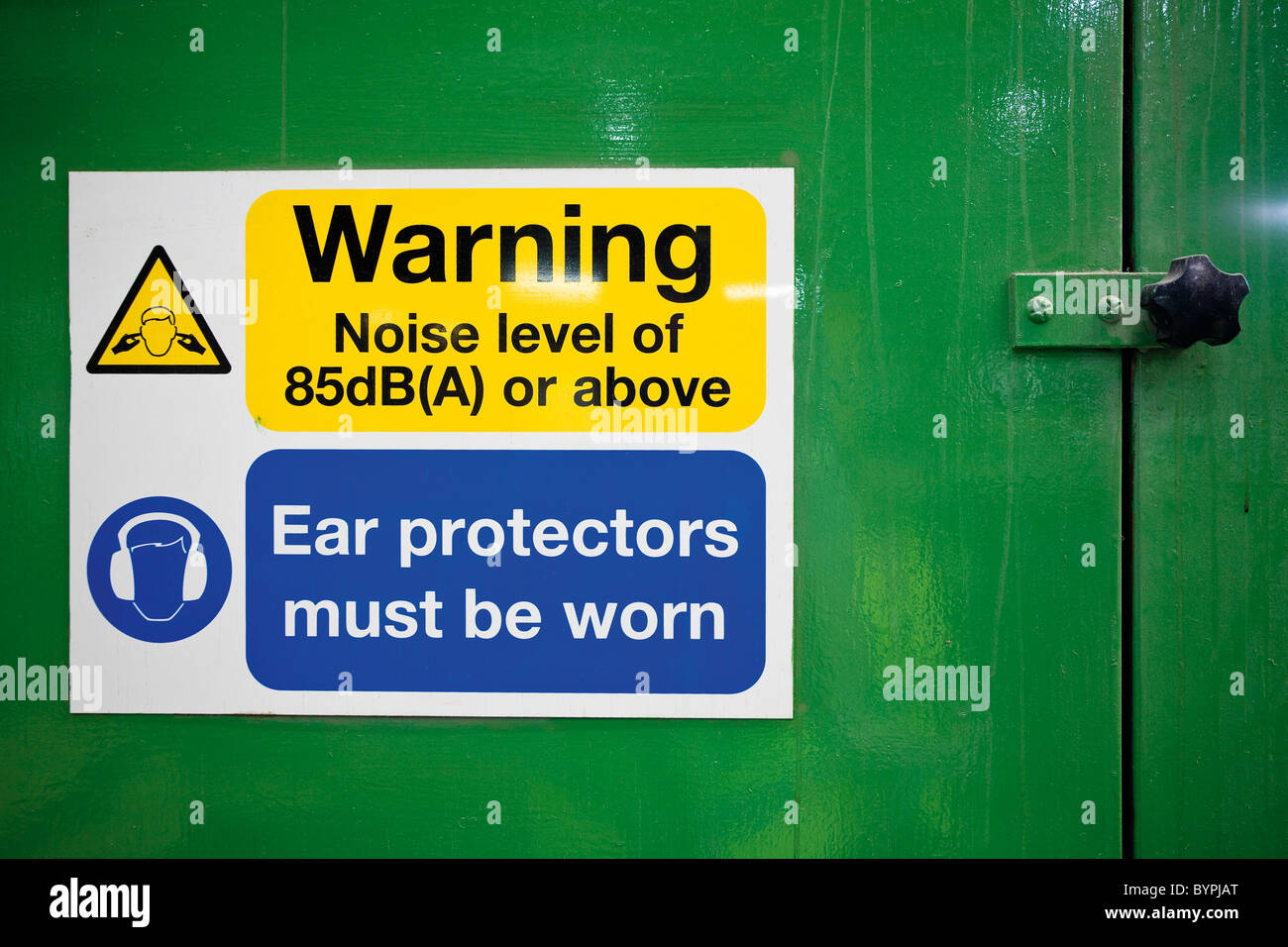 Sign warning of high levels of noise and the need to wear ear protectors Stock Photo
