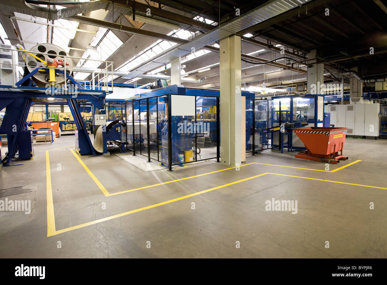 Carpet factory, pedestrian walkway and ultrasonic cutting machine - Stock Image