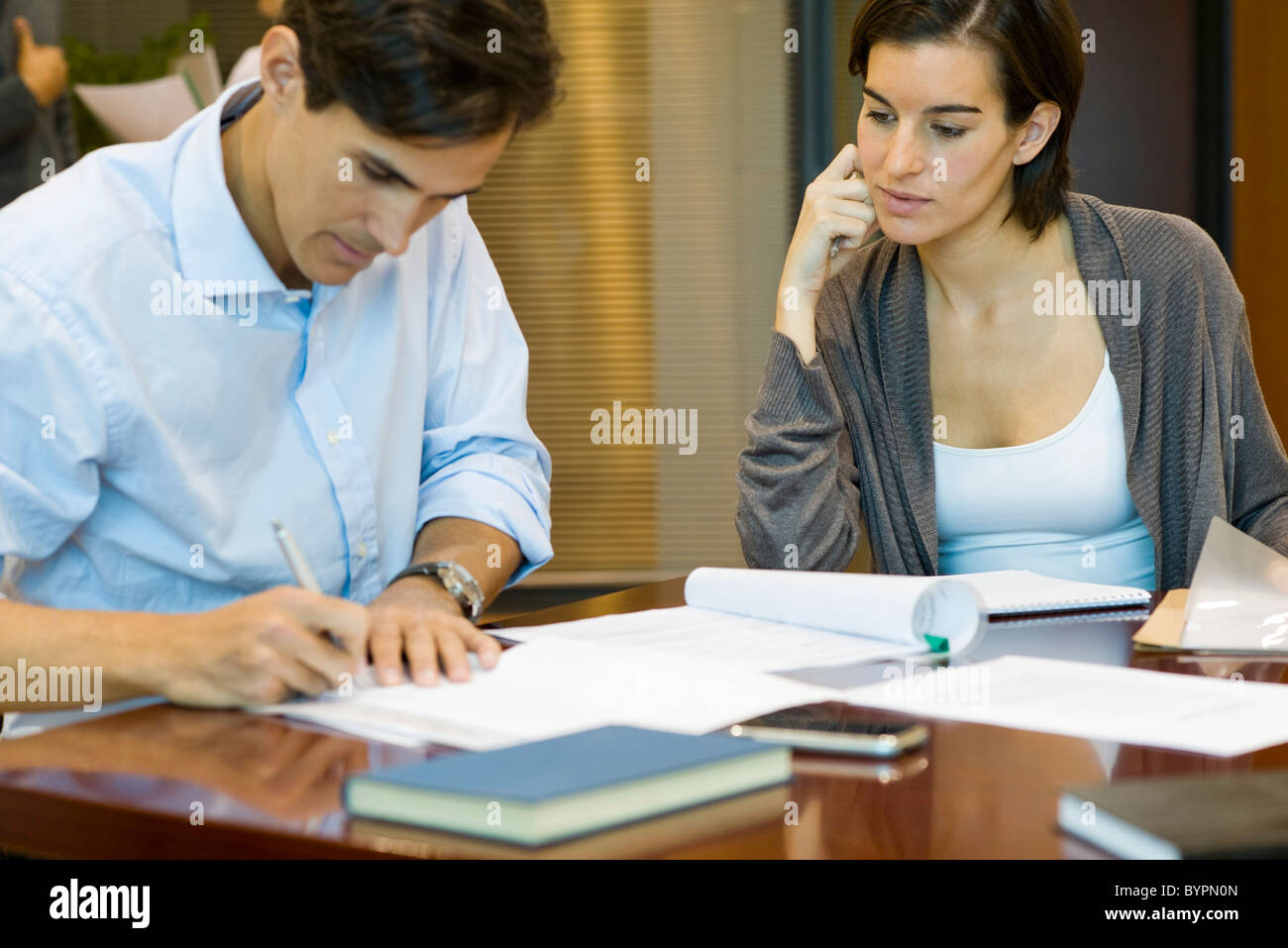 Executives doing paperwork together - Stock Image