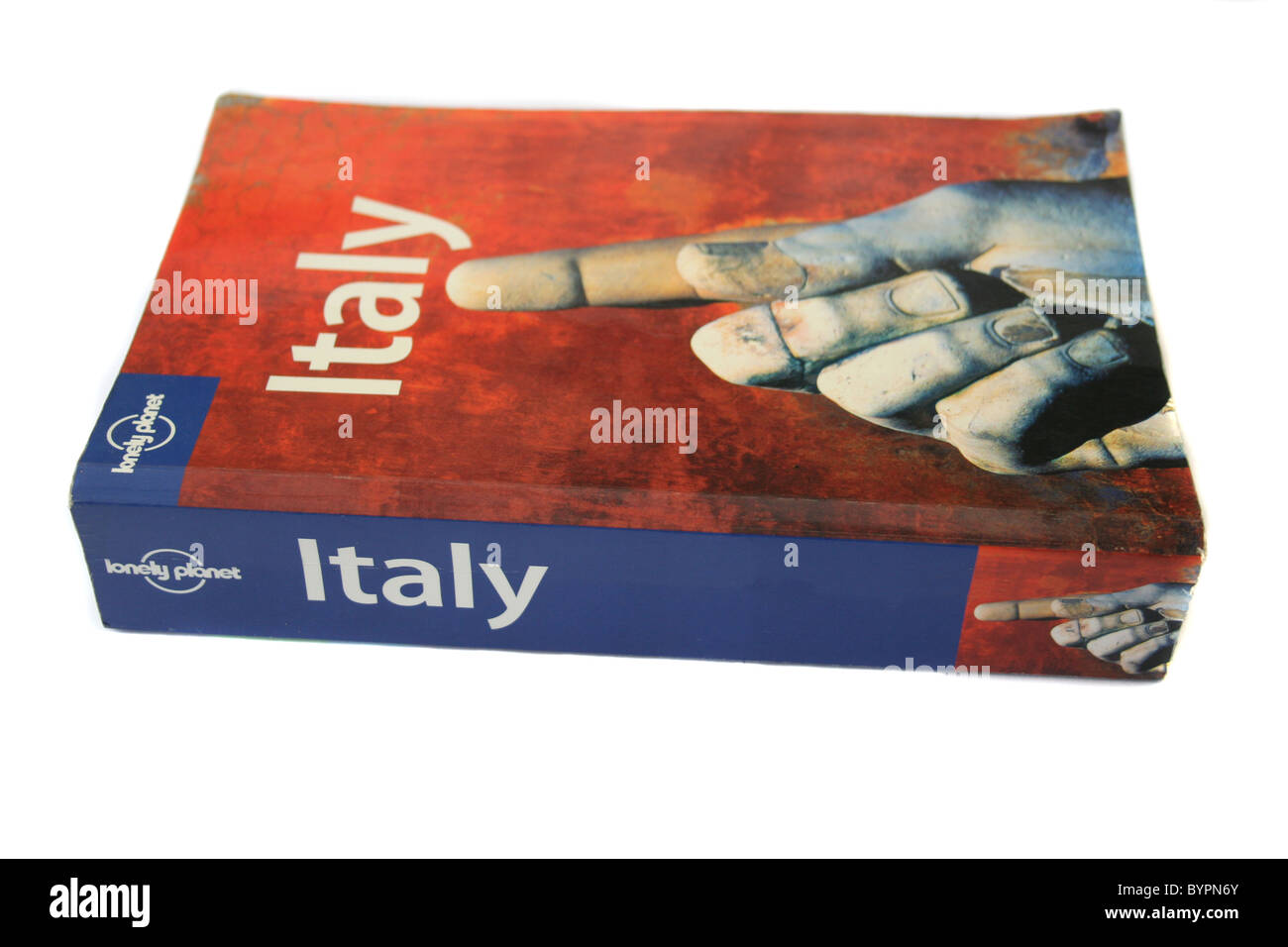 Lonely planet travel book to Italy on a white back ground. Stock Photo