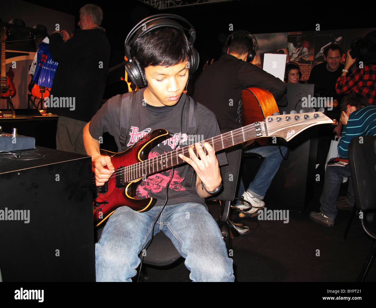 boy play with lag electric guitar the music show music and stock photo 34307897 alamy. Black Bedroom Furniture Sets. Home Design Ideas