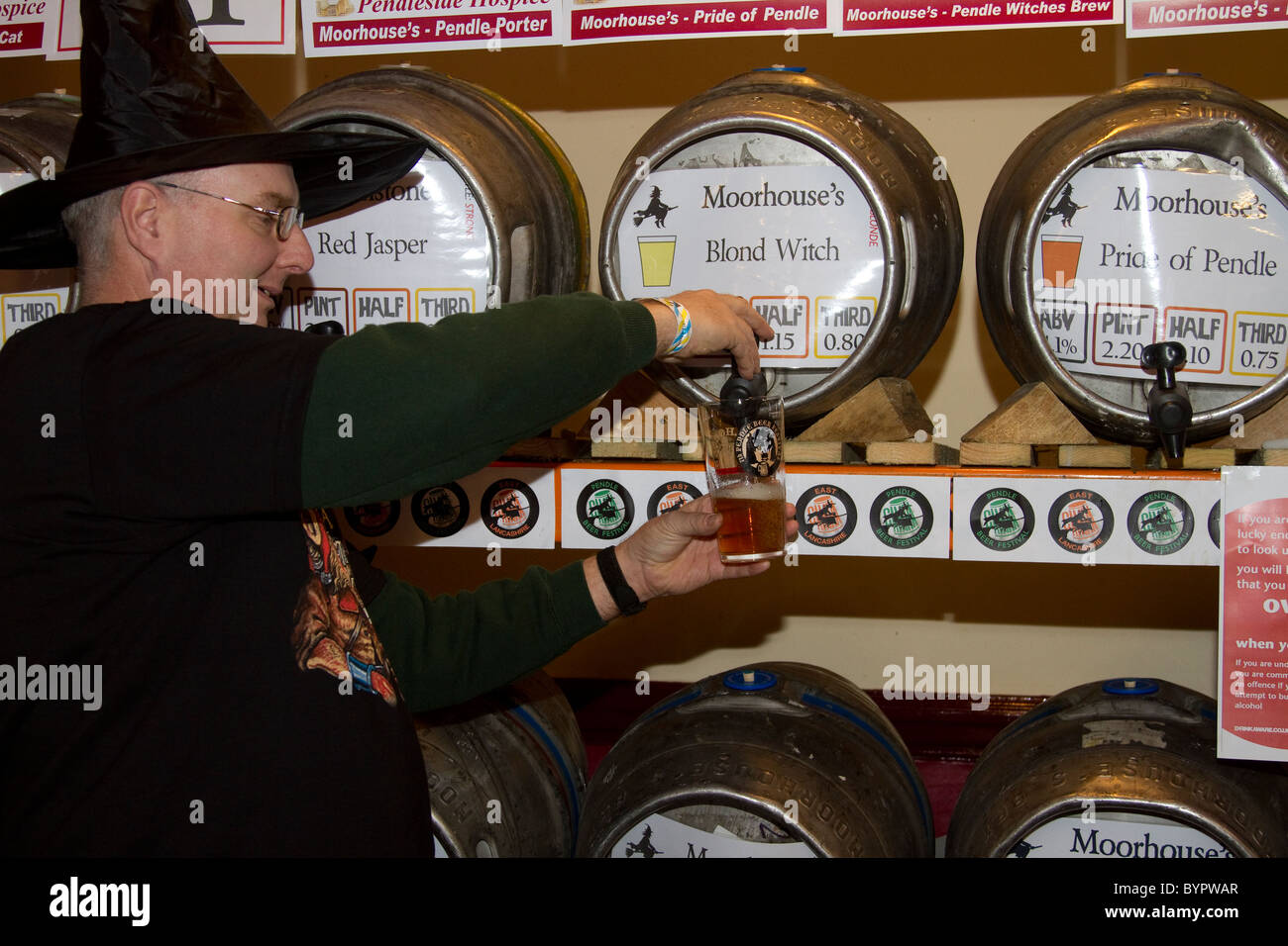 Racking and Stillage _ Man Pouring a Pint at the 7th Pendle Beer Festival. Colne, Lancashire, UK - Stock Image