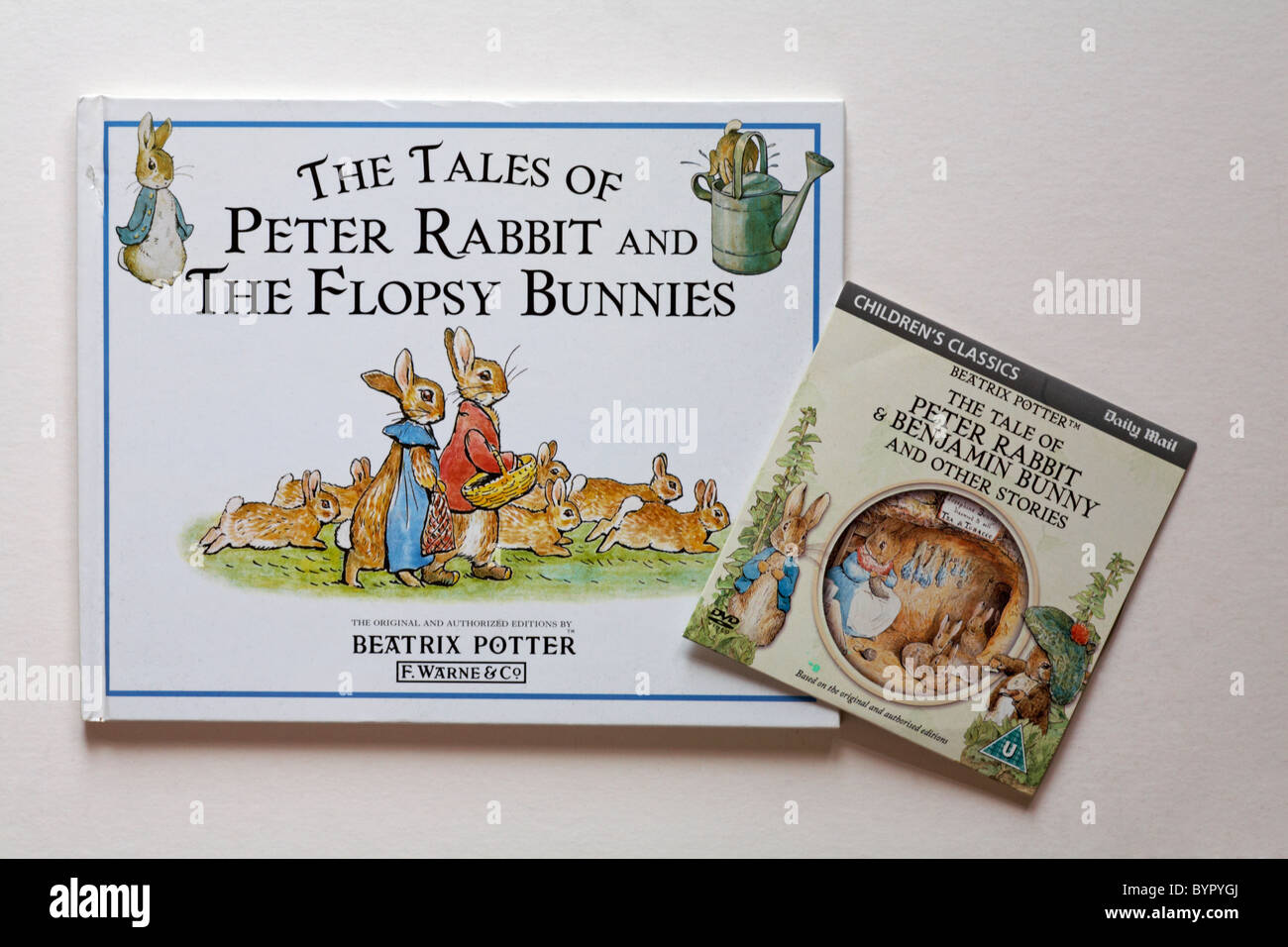 Beatrix Potter book and disc of the Tales of Peter Rabbit isolated on white background - Stock Image