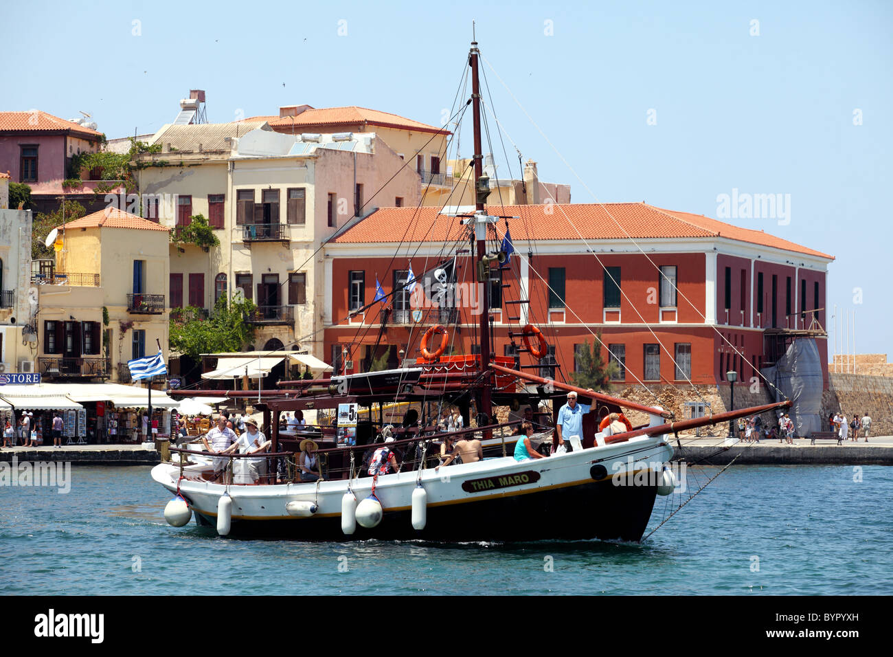 Trippers embark on a one-hour cruise from Chania to Lazaretta aboard the Thio Mara. - Stock Image