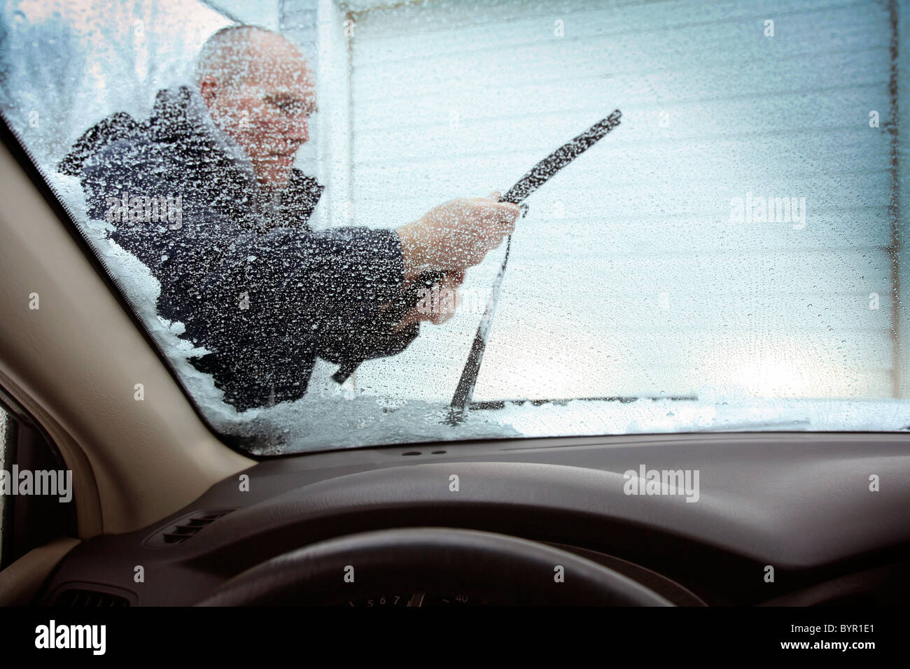 Changing a windshield wiper blade. - Stock Image